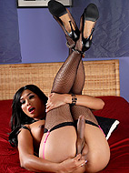 Pink lingerie. Hot TS Vaniity posing in exciting black stockings and pink lingerie