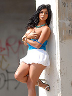 Street view. Irresistible shemale cutie Vaniity posing on a street