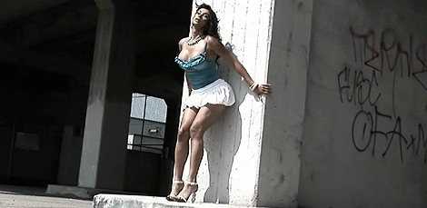 Street view. Naughty Vaniity posing in a exciting miniskirt