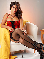 Red corset. TS sweetheart Vaniity posing in excited red corset