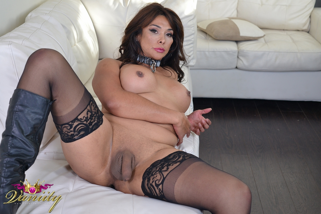 Vaniity in black and glittery gold sporting a violent thick cock